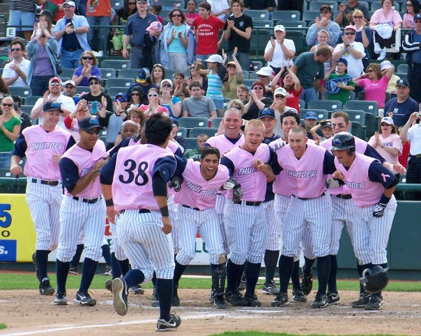 Jose Gil (38) is about to get mobbed by his teammates for hitting the game-winning home run.