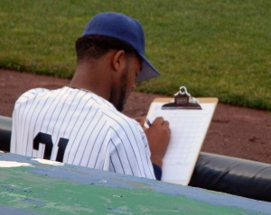 Newark Bears pitcher Leondy Perez charts the game from the dugout on June 3 at Riverfront Stadium in Newark (Photo credit: Paul Hadsall)