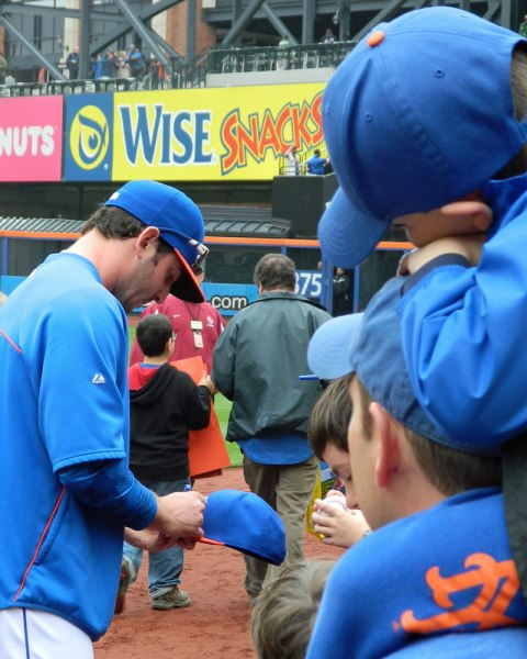 Matt Harvey signs a fan's baseball cap at Citi Field on Banner Day (Photo credit: Paul Hadsall)