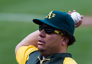 Bartolo Colon pitches for the Oakland Athletics in 2012 (Photo credit: Keith Allison via Flickr)