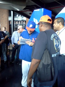 Mets catcher Travis d'Arnaud signs my friend's scorecard book before the game on Sept. 28, 2014 (Photo credit: Paul Hadsall)