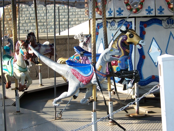 Is that a velociraptor on the carousel at Campbell's Field? velociraptor