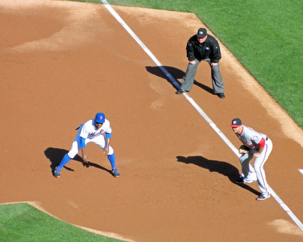 Curtis Granderson takes a lead off first base after leading off the Mets' last regular season game with a single on Oct. 4, 2015. (Photo credit: Paul Hadsall)